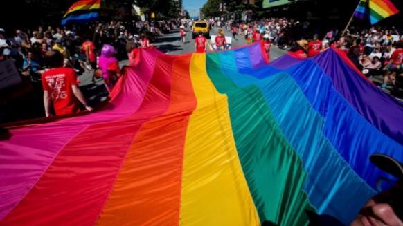 AIDS Emergency Fund large gay pride flag in pride parade