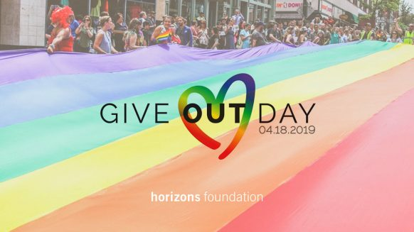 Give OUT Day logo on rainbow flag