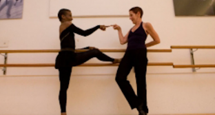Elvia and Bayan dance together in a dance studio.