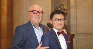 Randy Shields stands with his husband, Harrison Yeo, on their wedding day