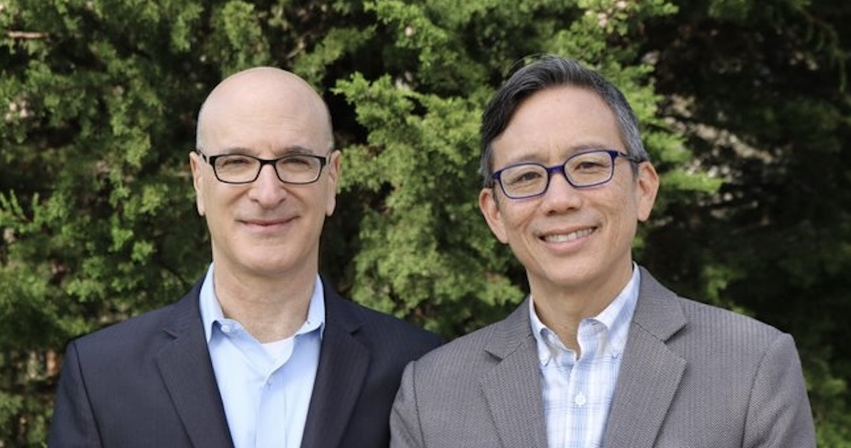 Mike Tekulsky (left) and Ron Wong (right) stand in front of a tree