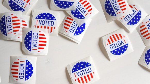 """""""I voted"""" stickers on a table"""