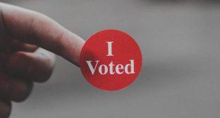 """Red """"I voted"""" sticker"""